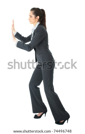young brunette attractive businesswoman push imaginary wall, isolated on white