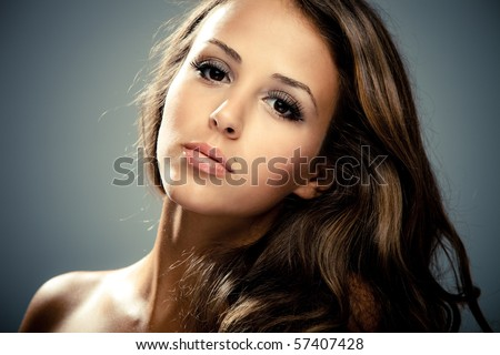 young brunette beauty  woman portrait, studio shot