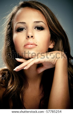 young brunette beauty  woman portrait, studio shot - stock photo