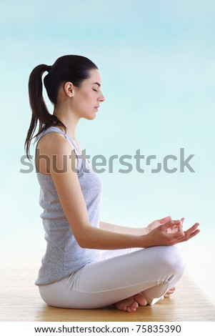 young brunette girl making yoga