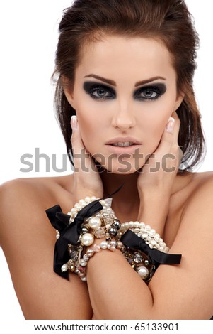 Young brunette lady with luxury accessories isolated on white background