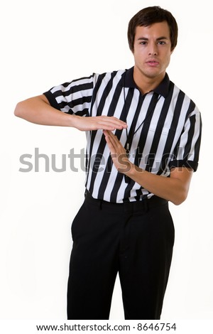 Young brunette man wearing a referee striped black and white top making the time out signal