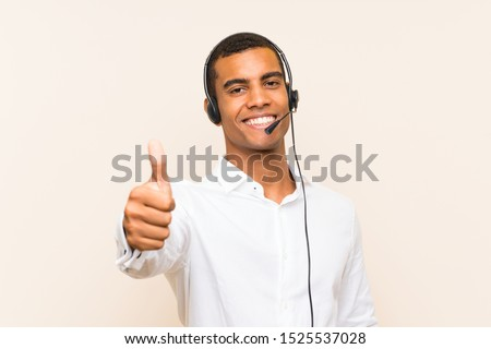 Young brunette man working with a headset #1525537028