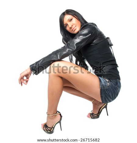 Young brunette posing in short skirt. Isolated over white background