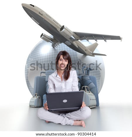 Young brunette sitting with a laptop with an Earth a plane taking off and a pile of luggage in the background