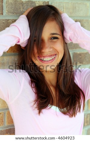 stock photo : young brunette teen girl smiling with braces