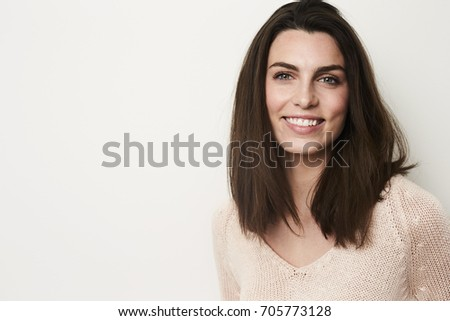 Young brunette with beautiful smile in studio #705773128