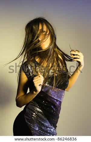 young brunette woman beauty portrait studio shot.