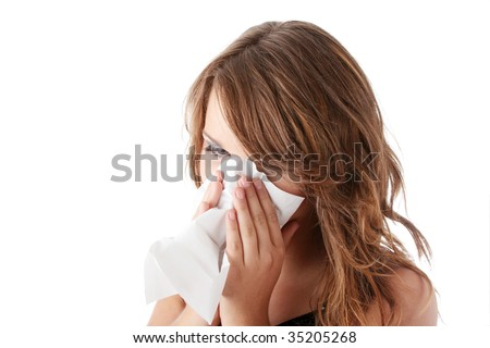 Young brunette woman having a cold close up isolated on white background