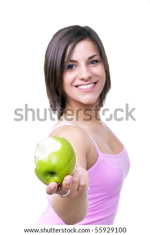 young brunette woman holding green apple on white