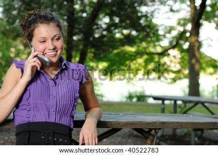 Young brunette woman on cell phone - laughing