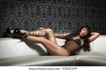Young brunette woman on the sofa