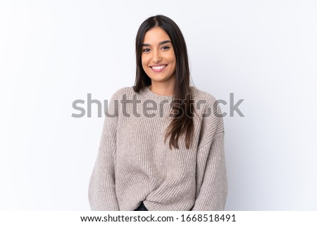 Young brunette woman over isolated white background laughing