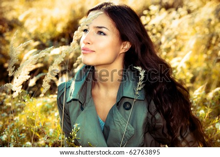 young brunette woman  portrait in autumn field