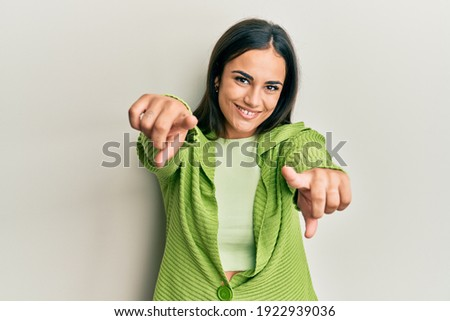 Young brunette woman wearing casual clothes pointing to you and the camera with fingers, smiling positive and cheerful  Photo stock ©