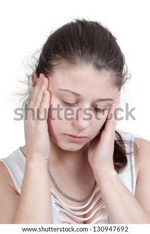 young brunette woman with splitting headache - isolated on white background