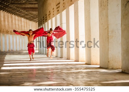 Young Buddhism novices are playing and relaxing at Shwezigon tem