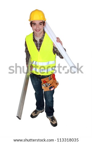 Young builder with plans