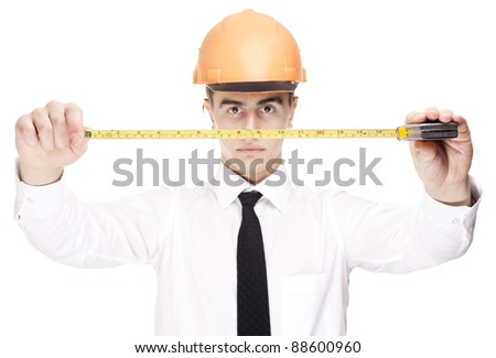 young builder with yellow tape measure