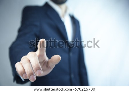 young buiness man finger touching in screen #670215730