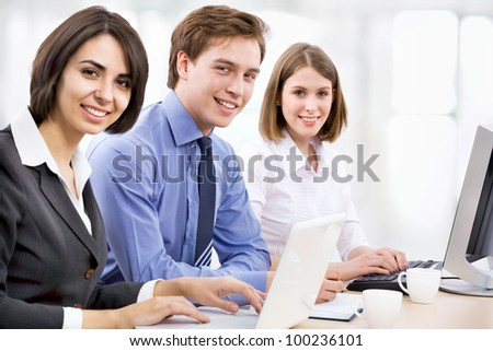 Young business collegues working in the office