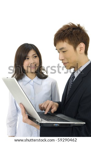 Young business couple with laptop over white