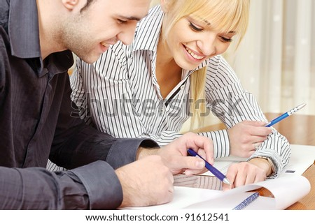 Young business couple work in office and laughing