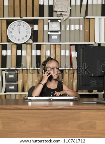 Young Business girl on the phone in front of a computer