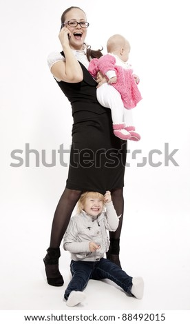 Young business lady with her little children
