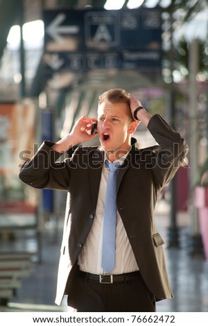 Young business man angry at telephon