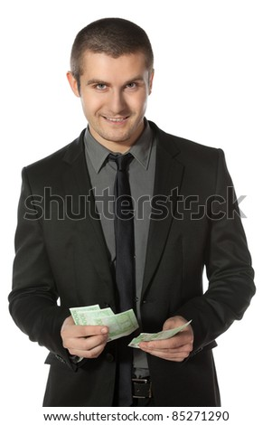 Young business man counting Euro money over white background