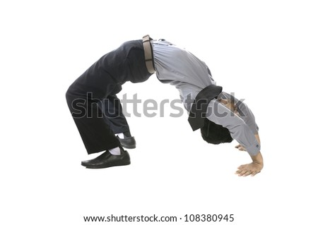 Young business man do acrobatic position isolated over white background