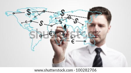 Young business man drawing a global network with Dollar Signs on world map.  The metaphor of international communication around the world. On a gray background.