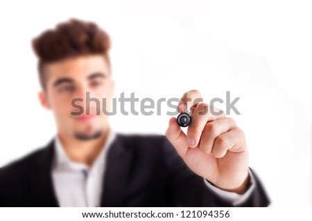 Young business man drawing with marker on empty copy space isolated on white