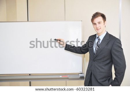 young business man explain at the whiteboard