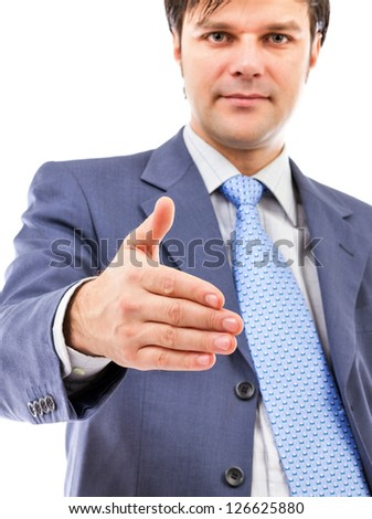 Young business man giving hand for handshake isolated on white background
