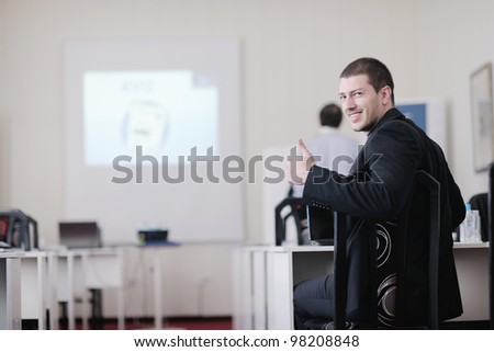 young business man giving presentation and education leassons on seminar event in small bright conference room - stock photo
