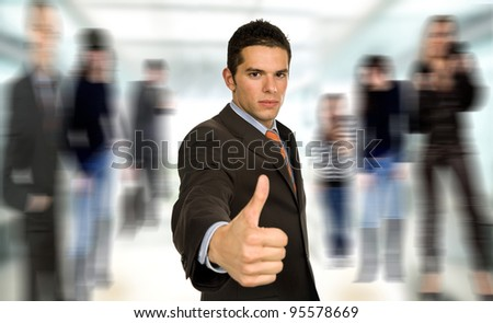 young business man going thumb up