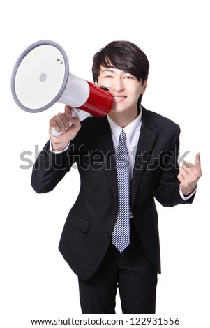 Young business man happy shouting into a megaphone isolated over a white background, asian model