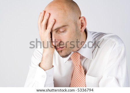 Young business man, head resting on palm, ache