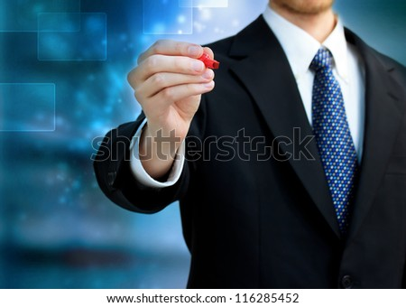 Young business man holding a red pen