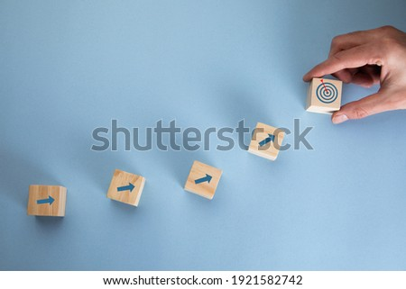 young business man holding cubes and target