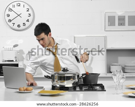 young business man in the kitchen with computer