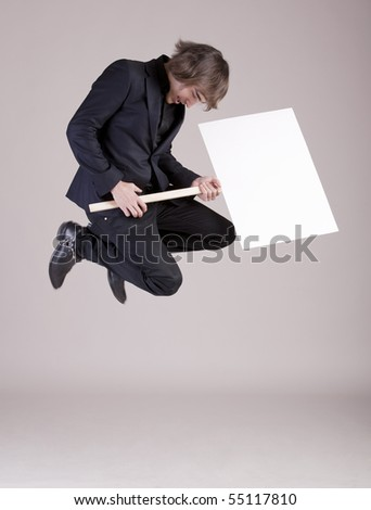 Young business man jumping with a space box