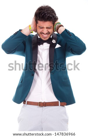 Young business man keeping his ears shut