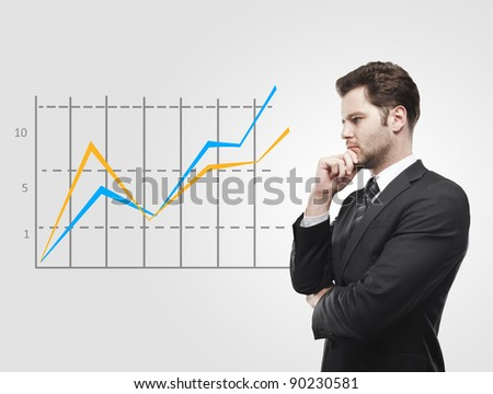 Young business man look at a graph. Rising arrow, representing business growth. On a gray background