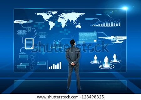 young business man looking on futuristic virtual screen