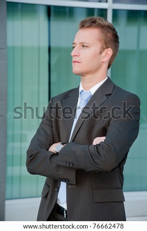 Young business man looking to the future