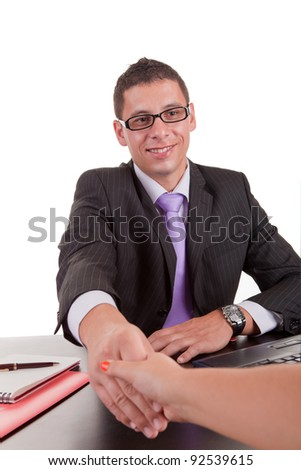 Young business man offering handshake