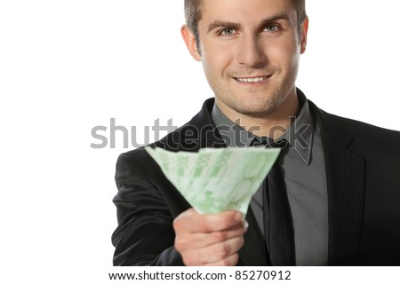 Young business man offering pack of Euro money over white background